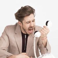 man shouting at phone